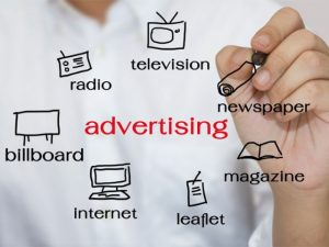 Whiteboard showing advertising options of different media
