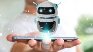 Photo of a hand holding a smartphone with a droid bot hovering above.