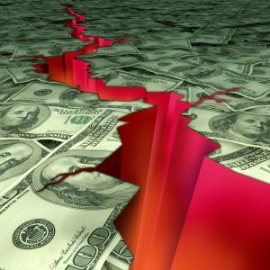Image of the ground if it was U.S. paper currency and an economic earthquake fissure running through it.