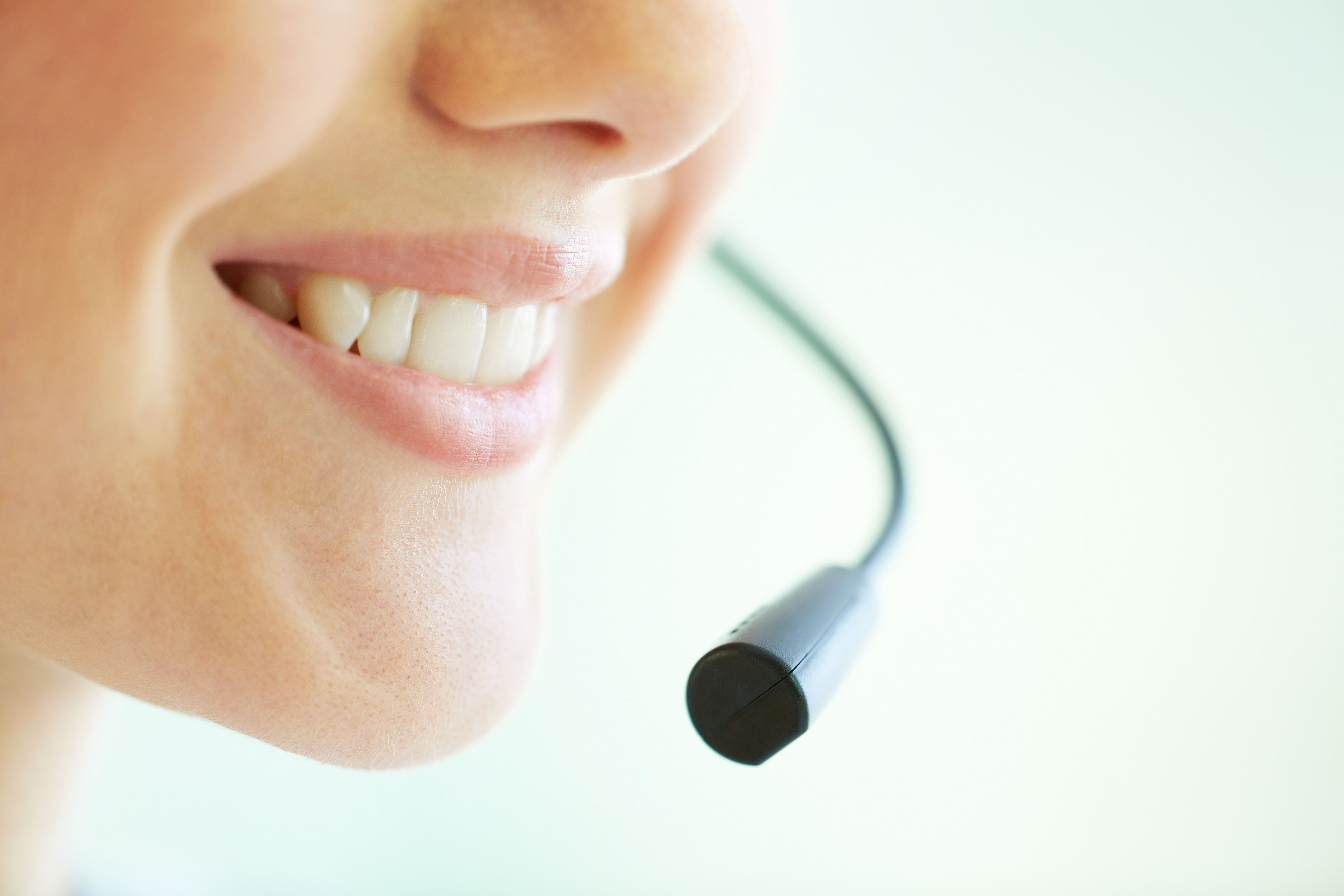 Smiling receptionist talking to a customer
