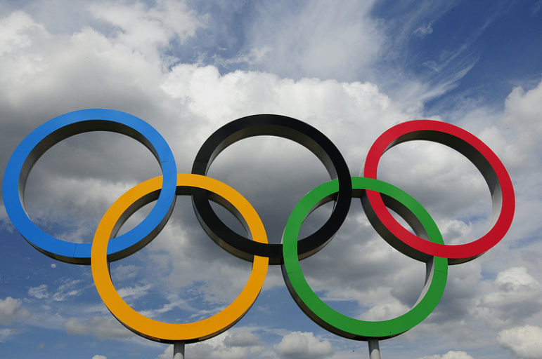 Photo of Olympic Rings against a cloudy sky